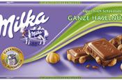 Milka Mliečna čokoláda z alpského mlieka s celými lieskovými orieškami 100 g